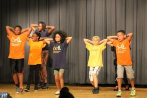BELL students perform at the end of summer closing ceremony attended by parents and siblings