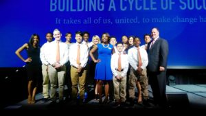 """Communities in Schools staff from Lakeview Middle at the United Way Campaign Kick-Off featured with """"The Lion Kings,"""" a student male leadership group who recited their daily affirmation to the large crowd of attendees"""